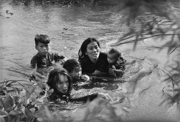 Kyōichi Sawada Japan Mother and her children wade across a river in Vietnam to escape US bombing 1965 3